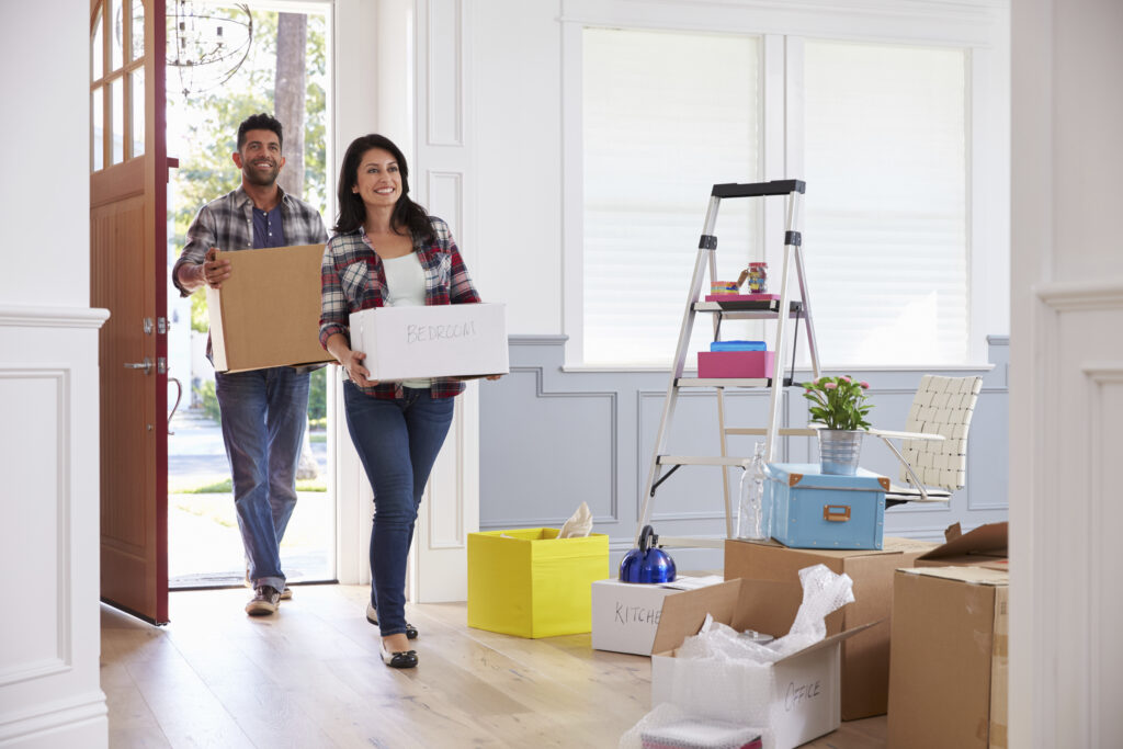 Young couple moving into a home after using a new construction cash back buyers agent