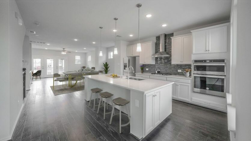 View of kitchen into Dining Room in Pulte Homes new construction home in Houston, TX